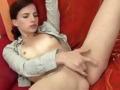 A youthfull woman who is only wearing an undid tee-shirt is laying on a bed in a studio. She has one gam hoisted up and is caressing her pussy. Stretching her gams broad she starts to finger screw herself until she comes.