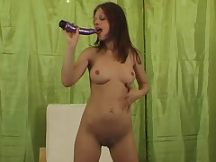 A youthfull chick who is only wearing a bathing suit top is standing in front of the camera. She is holding a meaty hitachi that she wets with her mouth. She plays around with the vibrator, takes her top off and pounds herself with it.