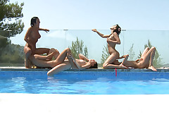 Titillating lezzie nymphomaniacs go nasty at the pool