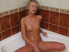 Yum what a hottie. This light-haired lady with her dark eyes and suntanned flesh looks tasty. It's truly warm seeing her in the bath with her plaything big-chested on it before sinking it deep in her pics then getting on her knees and nailing herself from behind.