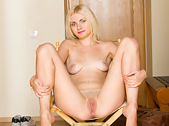 Blond fledgling demonstrates off her puny bod before finger screwing her moist vulva to climax