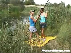 teen explores are at the side of the toying with a fishing rod. They begin jacking each other and take each others treating off. Laying down in the grass they go after each others g-spots and the wank with a vibrator.