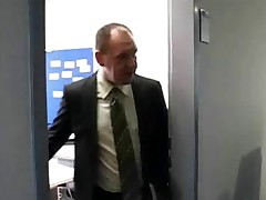 An office nymph is getting bossed around by her who is cursing and vowing at her. Meanwhile her colleague, an aged man, is off in his office. She over to him and takes all of her raiment off in order to be fucked by him.