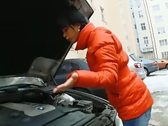 It's a cold winter day, and Kim is having problems getting her car to start. Luckily an older repairman is nearby and able to help out.